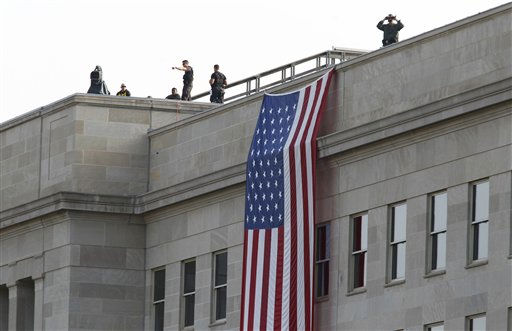 A Secret Service counter-sniper team looks out from atop the Pentagon during a tenth anniversary remembrance ceremony at the Pentagon Memorial in Washington Sunday, Sept. 11, 2011.   <span class=meta>(AP Photo&#47; J. Scott Applewhite)</span>