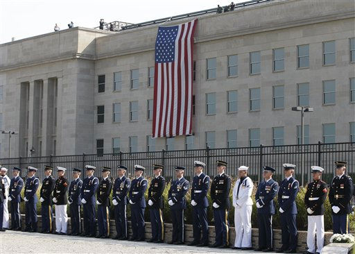 Honor guards stand at the Pentagon Memorial on the 10th anniversary of the September 11 attacks at the Pentagon in Washington, Sunday, Sept. 11, 2011.   <span class=meta>(AP Photo&#47; Charles Dharapak)</span>
