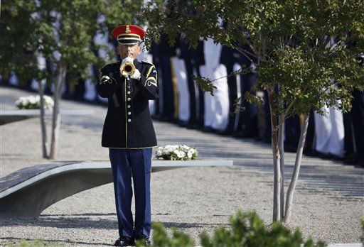 An honor guard plays Taps at the the Pentagon Memorial as the 10th anniversary of the September 11 attacks are observed at the Pentagon in Washington, Sunday, Sept. 11, 2011.   <span class=meta>(AP Photo&#47; Charles Dharapak)</span>