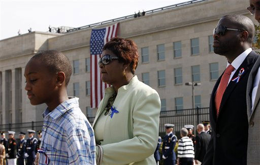 "<div class=""meta ""><span class=""caption-text "">Families gather at the Pentagon Memorial during the 10th anniversary commemorative ceremony of the September 11 attacks at the Pentagon in Washington, Sunday, Sept. 11, 2011.  (AP Photo/ Charles Dharapak)</span></div>"