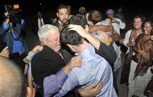 Freed American Josh Fattal, center in blue shirt, is hugged by relatives and friends upon his arrival from Iran, in Muscat, Oman Wednesday, Sept. 21, 2011. After more than two years in Iranian custody, two Americans convicted as spies took their first steps toward home Wednesday as they bounded down from a private jet and into the arms of family for a joyful reunion in the Gulf state of Oman. &#40;AP Photo&#47;Sultan Al-Hasani&#41; <span class=meta>(AP Photo&#47; Sultan Al-Hasani)</span>