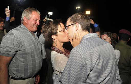 Freed American Shane Bauer, right, kisses fiancee Sarah Shourd upon his arrival from Iran, in Muscat, Oman Wednesday, Sept. 21, 2011. After more than two years in Iranian custody, two Americans convicted as spies took their first steps toward home Wednesday as they bounded down from a private jet and into the arms of family for a joyful reunion in the Gulf state of Oman. &#40;AP Photo&#47;Sultan Al-Hasani&#41; <span class=meta>(AP Photo&#47; Sultan Al-Hasani)</span>