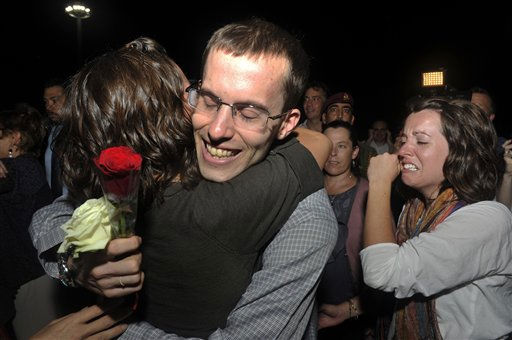 Freed American Shane Bauer, center is welcomed upon his arrival from Iran, in Muscat, Oman Wednesday, Sept. 21, 2011. After more than two years in Iranian custody, two Americans convicted as spies took their first steps toward home Wednesday as they bounded down from a private jet and into the arms of family for a joyful reunion in the Gulf state of Oman. &#40;AP Photo&#47;Sultan Al-Hasani&#41; <span class=meta>(AP Photo&#47; Sultan Al-Hasani)</span>