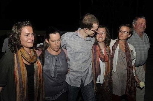 Freed American Shane Bauer, center, meets his relatives and friends upon his arrival from Iran, in Muscat, Oman Wednesday, Sept. 21, 2011. After more than two years in Iranian custody, two Americans convicted as spies took their first steps toward home Wednesday as they bounded down from a private jet and into the arms of family for a joyful reunion in the Gulf state of Oman. &#40;AP Photo&#47;Sultan Al-Hasani&#41; <span class=meta>(AP Photo&#47; Sultan Al-Hasani)</span>