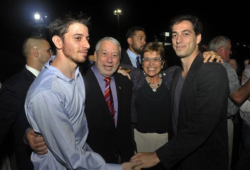"<div class=""meta ""><span class=""caption-text "">Freed American Josh Fattal, left, meets his relatives and friends upon his arrival from Iran, in Muscat, Oman Wednesday, Sept. 21, 2011. After more than two years in Iranian custody, two Americans convicted as spies took their first steps toward home Wednesday as they bounded down from a private jet and into the arms of family for a joyful reunion in the Gulf state of Oman. (AP Photo/Sultan Al-Hasani) (AP Photo/ Sultan Al-Hasani)</span></div>"