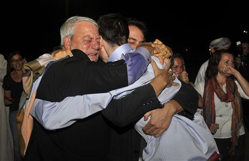 Freed American Josh Fattal, center in blue shirt, hugs his relatives upon his arrival from Iran, in Muscat, Oman Wednesday, Sept. 21, 2011. After more than two years in Iranian custody, two Americans convicted as spies took their first steps toward home Wednesday as they bounded down from a private jet and into the arms of family for a joyful reunion in the Gulf state of Oman. &#40;AP Photo&#47;Sultan Al-Hasani&#41; <span class=meta>(AP Photo&#47; Sultan Al-Hasani)</span>