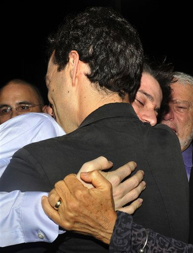 "<div class=""meta ""><span class=""caption-text "">Freed American Josh Fattal, center in blue shirt, hugs his family members and relatives upon his arrival from Iran, in Muscat, Oman Wednesday, Sept. 21, 2011. After more than two years in Iranian custody, two Americans convicted as spies took their first steps toward home Wednesday as they bounded down from a private jet and into the arms of family for a joyful reunion in the Gulf state of Oman. (AP Photo/Sultan Al-Hasani) (AP Photo/ Sultan Al-Hasani)</span></div>"