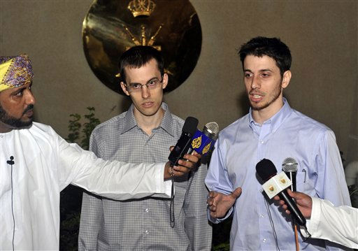 Freed American Shane Bauer, center, and Josh Fattal, right, talk to the media upon their arrival from Iran, in Muscat, Oman Wednesday, Sept. 21, 2011. After more than two years in Iranian custody, two Americans convicted as spies took their first steps toward home Wednesday as they bounded down from a private jet and into the arms of family for a joyful reunion in the Gulf state of Oman. &#40;AP Photo&#47;Sultan Al-Hasani&#41; <span class=meta>(AP Photo&#47; Sultan Al-Hasani)</span>