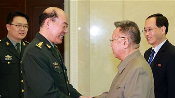 "<div class=""meta ""><span class=""caption-text "">In this photo released by China's Xinhua News Agency, North Korean leader Kim Jong Il, second right, greets visiting  Director of the General Political Department of the People's Liberation Army (PLA) of China Li Jinai in Pyongyang, North Korea, Thursday, Nov. 17, 2011. Li told Kim that China's army wanted to enhance understanding and mutual trust and strengthen practical exchanges with the North Korean military. (AP Photo/Xinhua, Zhang Li) NO SALES (AP Photo/ Zhang Li)</span></div>"