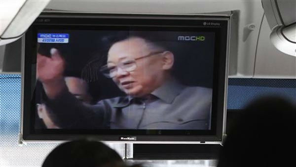 South Korean passengers watch a television broadcasting a death of North Korean leader Kim Jong Il on a bus in Ulsan, South Korea, Monday, Dec. 19, 2011. Kim Jong Il, North Korea&#39;s mercurial and enigmatic leader, has died. He was 69. &#40;AP Photo&#47;Ahn Young-joon&#41; <span class=meta>(AP Photo&#47; Ahn Young-joon)</span>