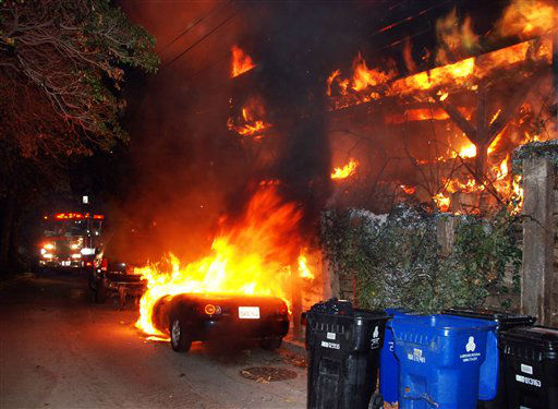 "<div class=""meta ""><span class=""caption-text "">A Los Angeles Fire Department engine arrives at a fire in the Laurel Canyon section of Los Angeles on Friday Dec.30,2011. An arsonist torched car after car early Friday, sending firefighters scrambling to put out more than a dozen blazes in Hollywood and neighboring West Hollywood. The fires started shortly after midnight and occurred over a four-hour span before dawn. (AP Photo/Mike Meadows) (AP Photo/ Mike Meadows)</span></div>"