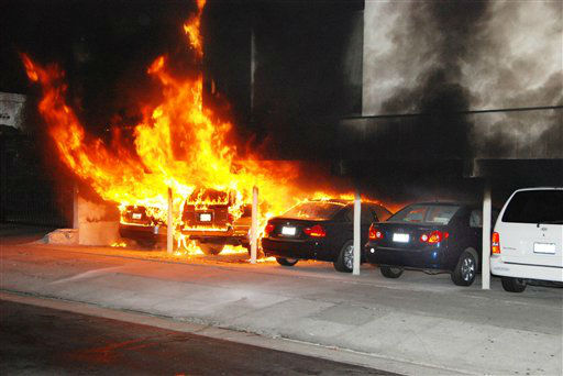 "<div class=""meta ""><span class=""caption-text "">Burning cars are shown at the site of an arson fire in the Hollywood section of Los Angeles on Friday Dec.30, 2011. An arsonist torched car after car early Friday, sending firefighters scrambling to put out more than a dozen blazes in Hollywood and neighboring West Hollywood. The fires started shortly after midnight and occurred over a four-hour span before dawn. (AP Photo/Mike Meadows) (AP Photo/ Mike Meadows)</span></div>"