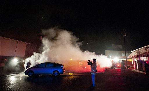 "<div class=""meta ""><span class=""caption-text "">A Los Angeles Fire Department firefighter extinguishes a car on fire in a parking lot in the Sherman Oaks neighborhood of Los Angeles on Monday, Jan. 2, 2012. For the fifth night in a row, a spate of arson fires has sent firefighters scrambling to extinguish car fires in the Hollywood, Hollywood Hills, Studio City, and Sherman Oaks neighborhoods of Los Angeles. The Los Angeles Fire Department confirms a person of interest has been detained and is being questioned in connection with the arson spree. (AP Photo/Dan Steinberg) (AP Photo/ DAN STEINBERG)</span></div>"
