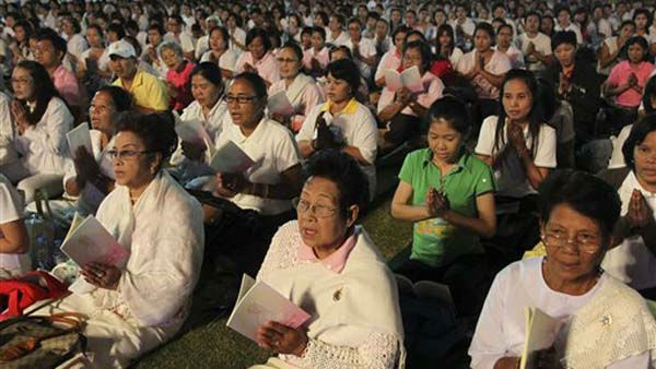 Buddhist Thais recite sutras during a mass prayer as part of a New Year celebrations in Bangkok, Thailand, Saturday, Dec. 31, 2011. &#40;AP Photo&#47;Apichart Weerawong&#41; <span class=meta>(AP Photo&#47; Apichart Weerawong)</span>