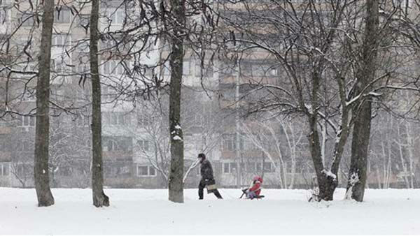 Mother pulls a snow-sled with her child during a heavy snowfall on the New Year&#39;s eve in Sofia, on Monday, Saturday Dec 31, 2011. Weather forecasts say the last day of the year will be windy and cold on the Balkans. &#40;AP Photo&#47;Valentina Petrova&#41; <span class=meta>(AP Photo&#47; Valentina Petrova)</span>