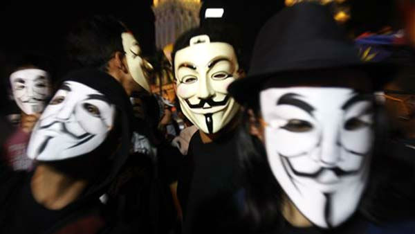 Activists wear Guy Fawkes masks during New Year&#39;s Eve celebrations at Independence Square in Kuala Lumpur, Malaysia, Saturday, Dec. 31, 2011. &#40;AP Photo&#47;Lai Seng Sin&#41; <span class=meta>(AP Photo&#47; Lai Seng Sin)</span>