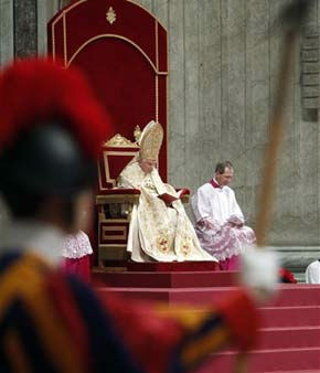 Pope Benedict XV, background center, is framed by a Swiss guard as he celebrates a New Year&#39;s Eve vespers service in St. Peter&#39;s Basilica, at the Vatican, Saturday, Dec. 31, 2011. &#40;AP Photo&#47;Pier Paolo Cito&#41; <span class=meta>(AP Photo&#47; Pier Paolo Cito)</span>