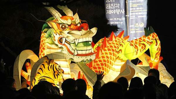 A giant dragon lantern is displayed to celebrate the New Year near the border village of Panmunjom &#40;DMZ&#41; that separates the two Koreas since the Korean War, at Imjingak Pavilion in Paju, South Korea, Sunday, Jan. 2012. The year 2012 is celebrated as the year of the dragon on the Chinese lunar calendar. &#40;AP Photo&#47;Ahn Young-joon&#41;. <span class=meta>(AP Photo&#47; Ahn Young-joon)</span>