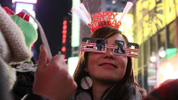 "<div class=""meta ""><span class=""caption-text "">Wearing 2012 glasses and a Happy New Year headpiece, Bernadette Brandl smiles as she takes part in the New Year's Eve festivities in New York's Times Square Saturday Dec. 31, 2011. Brandl, who is originally from Austria, is currently living in Minnesota.  (AP Photo/Tina Fineberg) (AP Photo/ Tina Fineberg)</span></div>"