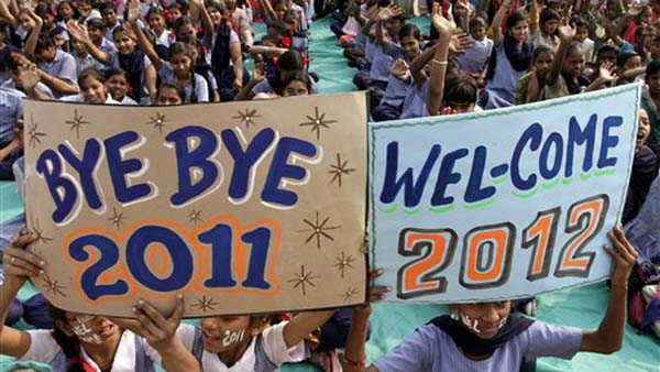 Indian school students hold placards during a celebration to welcome the New Year in Ahmadabad, India, Saturday, Dec. 31, 2011. &#40;AP Photo&#47;Ajit Solanki&#41; <span class=meta>(AP Photo&#47; Ajit Solanki)</span>