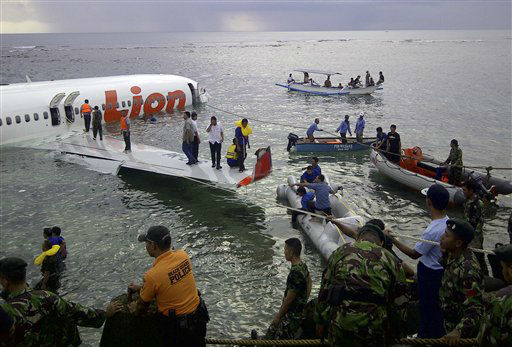 This photo released by Indonesia&#39;s National Rescue Team shows rescuers at the crash site of a Lion Air plane in Bali, Indonesia on Saturday, April 13, 2013. The plane carrying more than 100 passengers and crew overshot a runway on the Indonesian resort island of Bali on Saturday and crashed into the sea, injuring nearly two dozen people, officials said.   <span class=meta>(AP Photo&#47; Uncredited)</span>