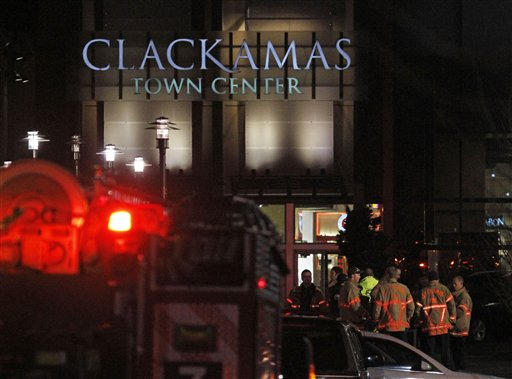 First responders stand outside where a gunman opened fire at the Clackamas Town Center shopping mall earlier in Portland, Ore., Tuesday, Dec. 11, 2012. Police say three people are dead, including the gunman.(AP Photo/Don Ryan)