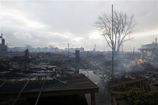 Damage caused by a fire at Breezy Point is shown Tuesday, Oct. 30, 2012, in in the New York City borough of Queen. The fire destroyed between 80 and 100 houses Monday night in the flooded neighborhood. More than 190 firefighters have contained the six-alarm blaze fire in the Breezy Point section, but they are still putting out some pockets of fire.   <span class=meta>(AP Photo&#47; Frank Franklin II)</span>