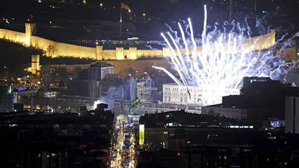 Fireworks light the sky shortly after midnight during New Year&#39;s celebrations in downtown Macedonia&#39;s capital Skopje, Sunday, Jan. 1, 2012. &#40;AP Photo&#47;Boris Grdanoski&#41; <span class=meta>(AP Photo&#47; Boris Grdanoski)</span>
