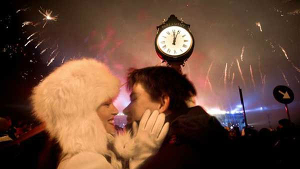 A couple kisses as fireworks explode in the sky over Bucharest, Romania, at midnight, Sunday, Jan. 1, 2012, during street celebrations of the new year. Large crowds gathered downtown Romania&#39;s capital taking advantage of the dry weather to attend the celebrations.&#40;AP Photo&#47;Vadim Ghirda&#41; <span class=meta>(AP Photo&#47; Vadim Ghirda)</span>