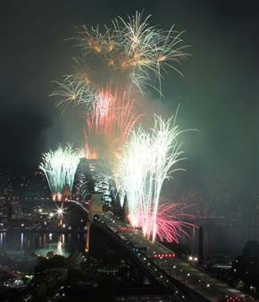 Fireworks burst over the Sydney Harbour Bridge during New Year&#39;s celebrations in Sydney, Sunday, Jan. 1, 2012. &#40;AP Photo&#47;Rick Rycroft&#41; <span class=meta>(AP Photo&#47; Rick Rycroft)</span>