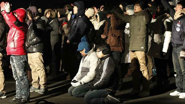 "<div class=""meta ""><span class=""caption-text "">South Korean Christians pray during a service to celebrate the New Year near the border village of Panmunjom (DMZ) that separates the two Koreas since the Korean War, at Imjingak Pavilion in Paju, South Korea, Sunday, Jan. 2012. (AP Photo/Ahn Young-joon) (AP Photo/ Ahn Young-joon)</span></div>"