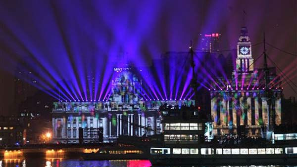 "<div class=""meta ""><span class=""caption-text "">The river front promenade called 'the Bund, one of the most popular tourist destinations in town, is illuminated to celebrate the New Year on Saturday, Jan. 1, 2012 in Shanghai, China.  (AP Photo) (AP Photo/ STR)</span></div>"