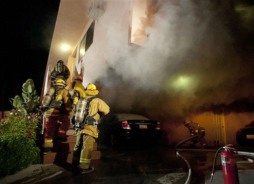 "<div class=""meta ""><span class=""caption-text "">Los Angeles Fire Department firefighters extinguishes a car on fire in a carport in the Sherman Oaks neighborhood of Los Angeles on Monday, Jan. 2, 2012. For the fifth night in a row, a spate of arson fires has sent firefighters scrambling to extinguish car fires in the Hollywood, Hollywood Hills, Studio City, and Sherman Oaks neighborhoods of Los Angeles. The Los Angeles Fire Department confirms a person of interest has been detained and is being questioned in connection with the arson spree. (AP Photo/Dan Steinberg) (AP Photo/ DAN STEINBERG)</span></div>"