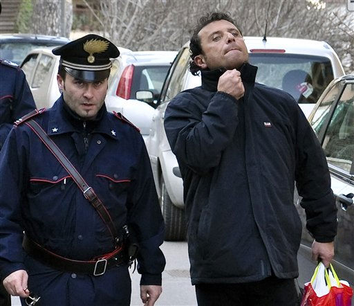 "<div class=""meta ""><span class=""caption-text "">In this photo taken on Saturday, Jan. 14, 2012, and made available, Wednesday, Jan. 18, 2012, Francesco Schettino, right,  the captain of the luxury cruiser Costa Concordia, which ran aground off Italy's Tuscan tiny island of Isola del Giglio, is taken into custody by Carabinieri in Porto Santo Stefano, Italy. Schettino, released on Tuesday, and currently under house arrest in his hometown of Meta di Sorrento, southern Italy, is investigated for manslaughter charges and abandoning the ship.   (AP Photo/ Giacomo Aprili)</span></div>"