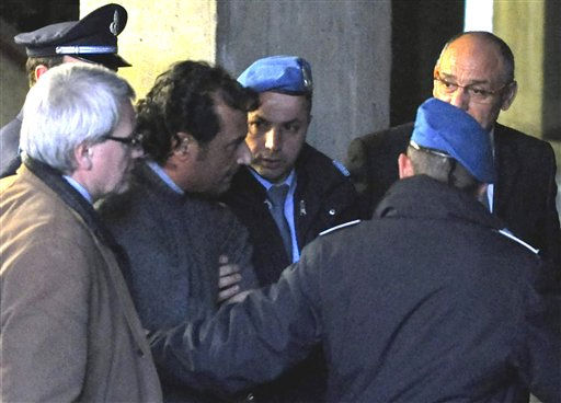 In this photo taken on Tuesday, Jan. 17, 2012, and made available Wednesday, Jan. 18, 2012, Francesco Schettino, third from left,  the captain of the luxury cruiser Costa Concordia, which ran aground off Italy&#39;s Tuscan tiny island of Isola del Giglio, arrives at the Law court in Grosseto, Italy, to be heard by investigators. Schettino, released soon after, and currently under house arrest in his hometown of Meta di Sorrento, southern Italy, is investigated for manslaughter charges and for abandoning the ship.   <span class=meta>(AP Photo&#47; Giacomo Aprili)</span>