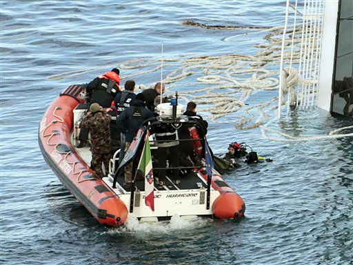 "<div class=""meta image-caption""><div class=""origin-logo origin-image ""><span></span></div><span class=""caption-text"">FILE - In this Tuesday, Jan. 17, 2012 file photo, Italian naval divers recover a body from the cruise ship Costa Concordia. The $450 million ship was carrying more than 4,200 passengers and crew when it slammed into a reef on Friday, Jan. 13, following an unauthorized maneuver by the captain. (AP Photo/Gregorio Borgia) (AP Photo/ Gregorio Borgia)</span></div>"