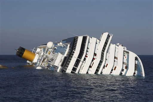 The cruise ship Costa Concordia lays on its side off the tiny Tuscan island of Giglio, Italy, Wednesday, Jan. 18, 2012. Italian searchers suspended operations on Wednesday after an enormous cruise ship grounded and partially submerged off the coast of Tuscany shifted slightly, creating concerns for the safety of divers and firefighters scouring the cruiseline for more than 20 passengers and crew still missing. &#40;AP Photo&#47;Andrea Sinibaldi, Lapresse&#41; <span class=meta>(AP Photo&#47; Andrea Sinibaldi)</span>