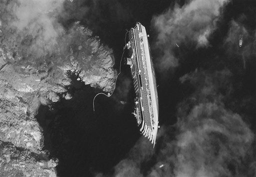 RETRANSMISSION FOR ALTERNATIVE CROP - This satellite image made Tuesday, Jan. 17, 2012, provided by DigitalGlobe on Wednesday, Jan. 18, 2012,  shows the hulk of the luxury cruise ship  Costa Concordia, which ran aground the Tuscan tiny island of Isola del Giglio, Italy, on Friday, leaning on its starboard side. As the Costa Concordia keeps shifting on its rocky ledge, many have raised the prospect of a possible environmental disaster if the 2,300 tonnes of fuel on the half-submerged cruise ship leaks. Satellites are used to monitor the area while authorities are preparing to remove the fuel from inside the vessel. &#40;AP Photo&#47;DigitalGlobe&#41;  MANDATORY CREDIT <span class=meta>(AP Photo&#47; Anonymous)</span>