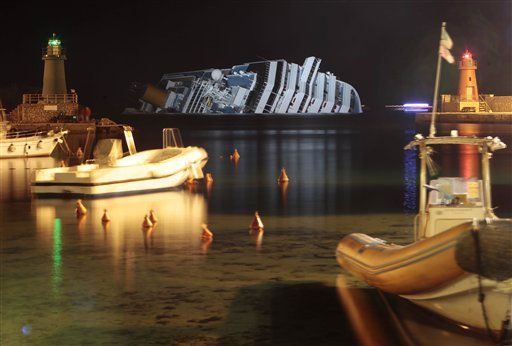 "<div class=""meta ""><span class=""caption-text "">The cruise ship Costa Concordia lies on its side after running aground off the tiny Tuscan island of Giglio, Italy, Wednesday, Jan. 18, 2012. The $450 million Costa Concordia cruise ship was carrying more than 4,200 passengers and crew when it slammed into a reef on Friday, Jan. 13, following an unauthorized maneuver by the captain. (AP Photo/Gregorio Borgia) (AP Photo/ Gregorio Borgia)</span></div>"