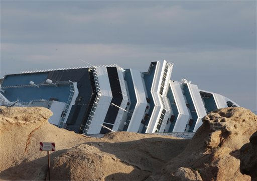 The cruise ship Costa Concordia leans on its side off the tiny Tuscan island of Giglio, Italy, Wednesday, Jan. 18, 2012.   <span class=meta>(AP Photo&#47; Gregorio Borgia)</span>
