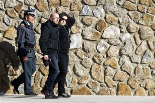 "<div class=""meta ""><span class=""caption-text "">Susy Albertini, right, the mother of five-year-old Dayana Arlotti who is missing after the Costa Concordia cruise ship run aground, is accompanied by her companion as they arrive on the tiny Tuscan island of Giglio, Italy, Friday, Jan. 20, 2012. The cruise ship grounded off Tuscany shifted again on its rocky perch, forcing the supension Friday of search and rescue operations for the 21 people still missing. It wasn't not clear if the movements registered overnight by onboard sensors were just vibrations as the Costa Concordia settles on the rocks off the Tuscan island of Giglio or if the massive ocean liner is slipping off the reef. (AP Photo/Angelo Carconi) (AP Photo/ Angelo Carconi)</span></div>"