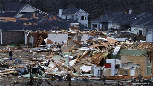 Residents walk around through the debris of their neighborhood after a tornado ripped through the Trussville, Ala. area in the early hours of Monday, Jan. 23, 2012. Jefferson County sheriff&#39;s spokesman Randy Christian said the storm produced a possible tornado that moved across northern Jefferson County around 3:30 a.m., causing damage in Oak Grove, Graysville, Fultondale, Center Point, Clay and Trussville.   <span class=meta>(AP Photo&#47; Butch Dill)</span>