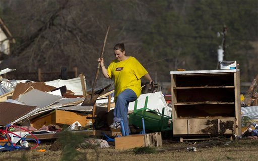 Amber Butler walks through the wreckage of her home in Oak Grove, Ala., Monday, Jan. 23, 2012. Jefferson County sheriff&#39;s spokesman Randy Christian said severe storms produced a possible tornado that moved across northern Jefferson County around 3:30 a.m., causing damage in Oak Grove, Graysville, Fultondale, Center Point, Clay and Trussville.  &#40;AP Photo&#47;Dave Martin&#41; <span class=meta>(AP Photo&#47; Dave Martin)</span>