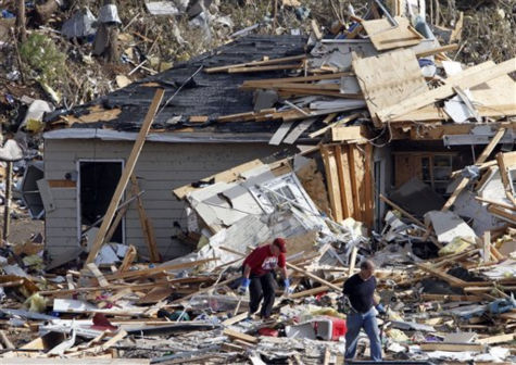 Residents comb through debris looking for personal belongings after a severe storm and possible tornado ripped through the Georgebrook subdivision area  in Trussville, Ala. in the early hours of Monday, Jan. 23, 2012.    <span class=meta>(AP Photo&#47; Butch Dill)</span>