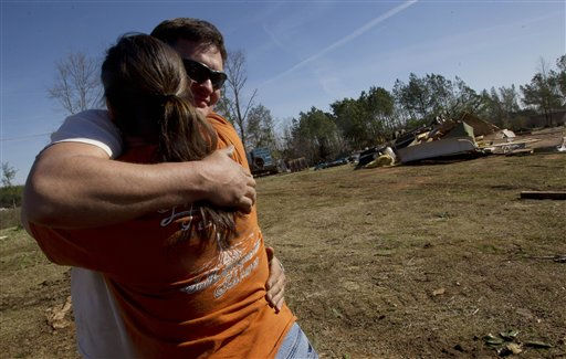 Jeremy Head gets a hug from his sister Jhan Powers as he takes a break from clean up in Oak Grove, Ala., Monday, Jan. 23, 2012. Jefferson County sheriff&#39;s spokesman Randy Christian said the storm produced a possible tornado that moved across northern Jefferson County around 3:30 a.m., causing damage in Oak Grove, Graysville, Fultondale, Center Point, Clay and Trussville.    <span class=meta>(AP Photo&#47; Dave Martin)</span>