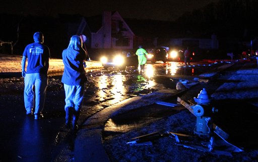 "<div class=""meta ""><span class=""caption-text "">Residents walk around through the debris as a severe storm ripped through the Trussville area in the early hours of Monday, Jan. 23, 2012, in Trussville, Ala.    (AP Photo/ Butch Dill)</span></div>"