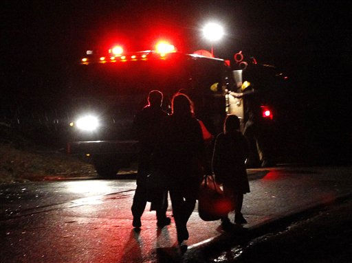 A family walks away from their home carrying a few possessions after a severe storm ripped through the Trussville area in the early hours of Monday, Jan. 23, 2012, in Trussville, Ala.    <span class=meta>(AP Photo&#47; Butch Dill)</span>
