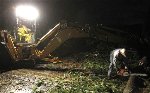 Rescue workers clear fallen trees for emergency personnel as a severe storm caused damage in the Trussville area in the early hours of Monday, Jan. 23, 2012, in Trussville, Ala.    <span class=meta>(AP Photo&#47; Butch Dill)</span>
