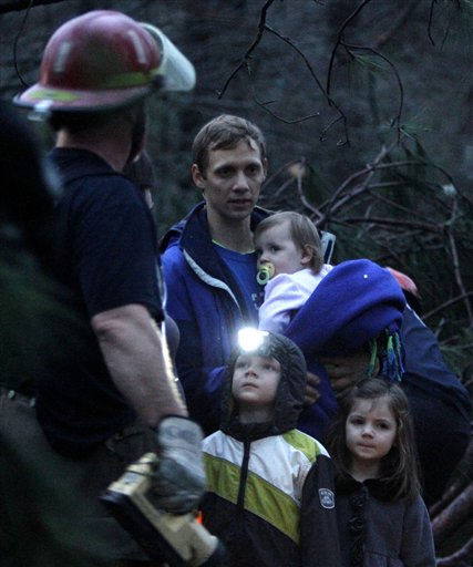 Rescue workers help a family out of their neighborhood after a tornado ripped through the Trussville area in the early hours of Monday, Jan. 23, 2012, in Trussville, Ala.    <span class=meta>(AP Photo&#47; Butch Dill)</span>