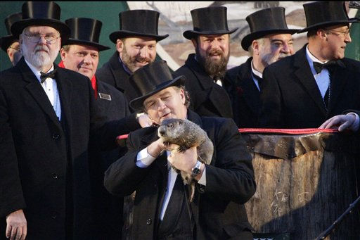 "<div class=""meta image-caption""><div class=""origin-logo origin-image ""><span></span></div><span class=""caption-text"">Groundhog Club handler John Griffiths holds Punxsutawney Phil, the weather prognosticating groundhog, during the 126th celebration of Groundhog Day on Gobbler's Knob in Punxsutawney, Pa. Thursday, Feb. 2, 2012. Phil saw his shadow, forecasting six more weeks of winter weather.   (AP Photo/ Gene J. Puskar)</span></div>"